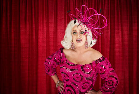Blond drag queen with hands on hips Stock Photo