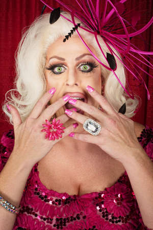 Surprised cross-dress performer with hands on mouth