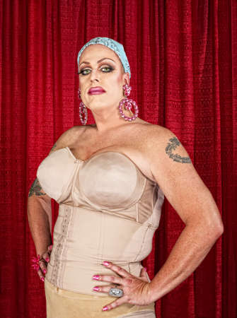 girdle: Tall white male in drag with tattoos on arms