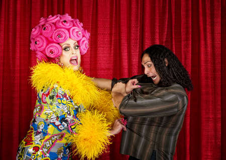mismatch: Excited drag queen in boa pulling on a man