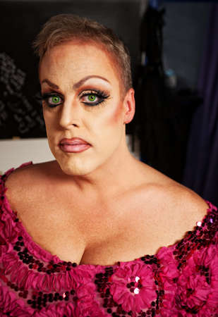 bbw: Serious drag queen without wig in dressing room