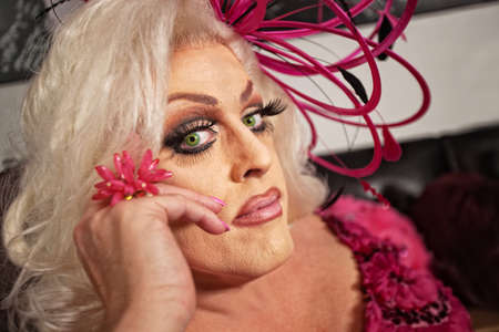 Close up of serious drag queen in blond Stock Photo