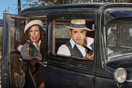 tommy: 1920s female gangster firing machine gun from car with partner