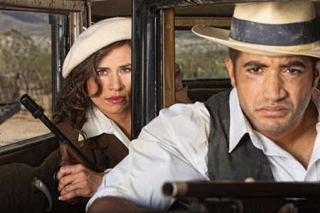Tough 1920s gangster male and female partners Stock Photo - 25015593