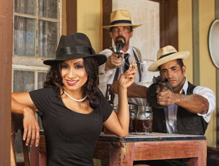 Whiskey bootleggers and beautiful woman pointing guns  photo