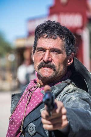 Serious Cowboy Points Gun at You