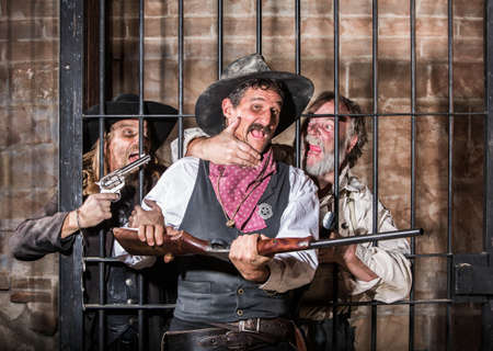 jail: Prisoners Revolt in an Old West Jail Stock Photo