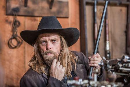 Portrait of a Stern Cowboy Stock Photo