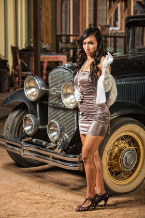 antique car: Smoking woman in mini skirt and high heels near old car