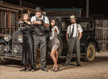 tommy: Dangerous 1920s vintage gangsters outside with weapons