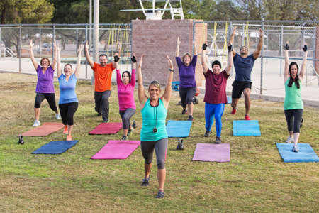 Diverse group of adults working out outdoors photo