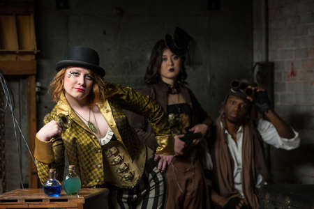 Three Steampunks with in Retro Lab with Potions photo