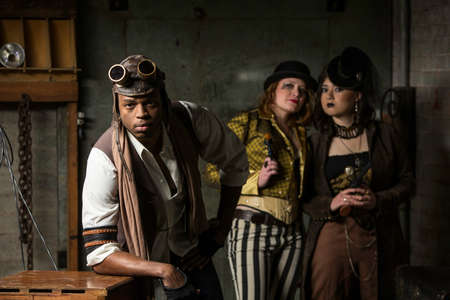 adventurer: Young Steam Punks PosIng in Underground Lair Stock Photo