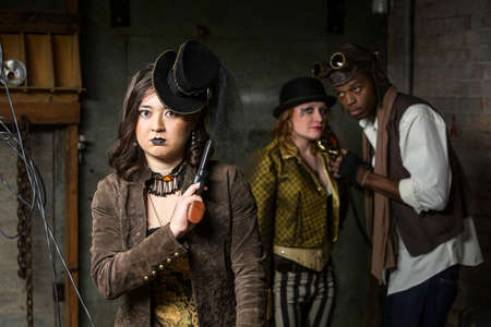 anachronistic: Young Steam Punks PosIng in Underground Lair Stock Photo