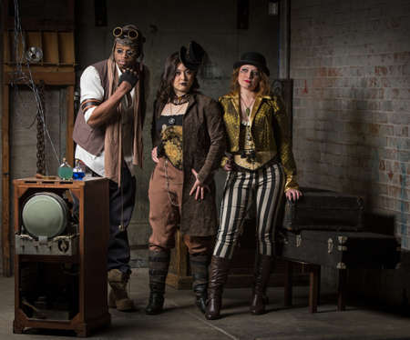 anachronistic: Three Young Diverse Steampunks in Retro Lair Stock Photo