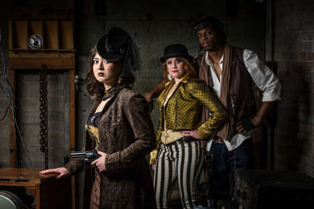 anachronistic: Three Armed Steampunks with in Retro Lab Stock Photo