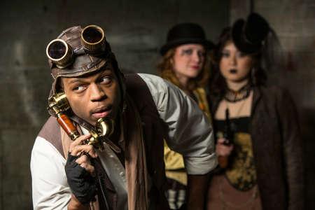 anachronistic: Steam Punks in Underground Lair with Retro Phone Stock Photo