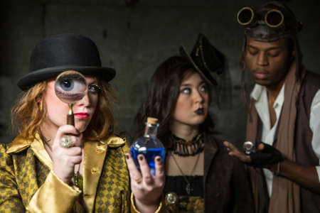 anachronistic: Steam Punks in Underground Lair with Potion and Magnifying Glass