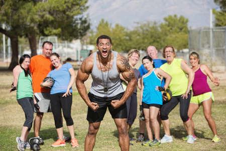 boasting: Loud boot camp fitness trainer and scared group Stock Photo