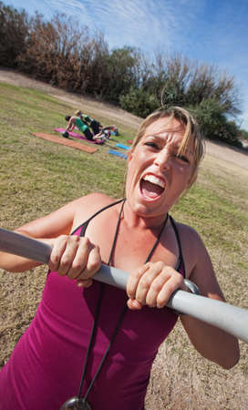 boot camp: Loud boot camp fitness instructor with outdoor class Stock Photo