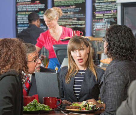 business skeptical: Diverse mature business executives meeting in cafeteria Stock Photo