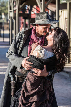 gallows: Portrait of an old west woman and sheriff kissing