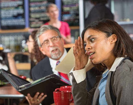disrespectful: Bored business woman with executive reading during lunch Stock Photo