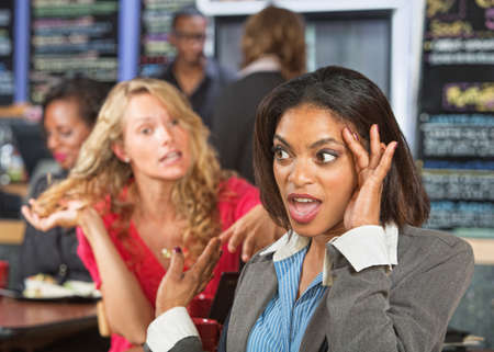 annoy: Irritated business woman listening to emotional lady
