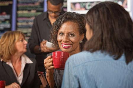 Beautiful business woman holding red coffee mug