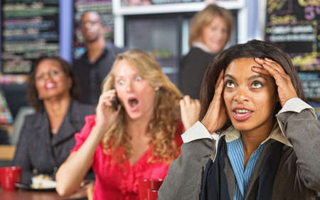 disrespectful: Annoyed lady listening to obnoxious woman on phone