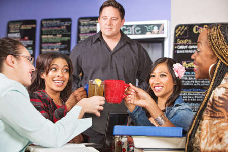 Male coffee house barista with students celebrating photo