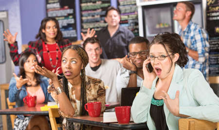 Group of people annoyed with obnoxious person on phone photo