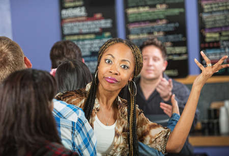 Annoyed young woman waiting in line at restaurant