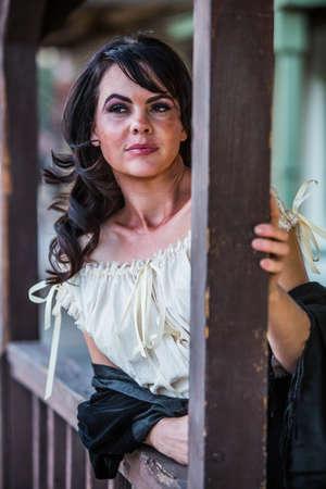 deadpan: Portrait of an old west saloon girl