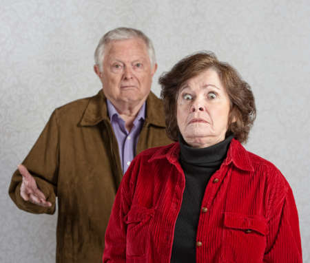 startled: Stiff older woman in front of confused man Stock Photo