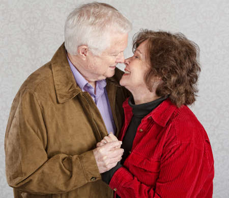 smooching: Loving older man and woman kissing each other