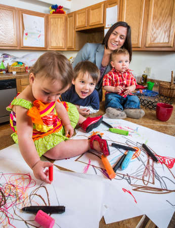 messy: Family spending time together in the kitchen Stock Photo