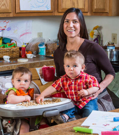 messy: Mother poses with children in the kitchen