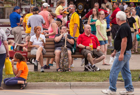 DES MOINES, IA USA - AUGUST 10: Attendees at the Iowa State Fair. Unidentified people enjoy food at the Iowa State Fair on August 10, 2014 in Des Moines, Iowa, USA.