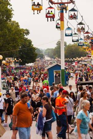 DES MOINES, IA USA - AUGUST 10: Attendees at the Iowa State Fair. Thousands of people filling the midway at the Iowa State Fair on August 10, 2014 in Des Moines, Iowa, USA.