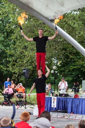 trouser: DES MOINES, IA USA - AUGUST 10: Red Trouser Show acrobats David Graham, below, and Tobin Renwick at the Iowa State Fair on August 10, 2014 in Des Moines, Iowa, USA.