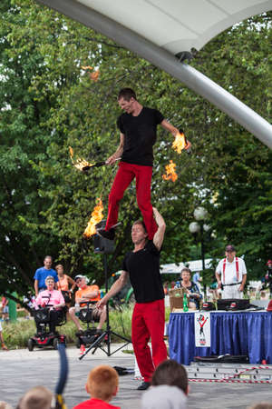 attendee: DES MOINES, IA USA - AUGUST 10: Red Trouser Show acrobats David Graham, below, and Tobin Renwick at the Iowa State Fair on August 10, 2014 in Des Moines, Iowa, USA.