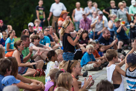 attendee: DES MOINES, IA USA - AUGUST 10: Unidentified girl in audience at the Iowa State Fair on August 10, 2014 in Des Moines, Iowa, USA. Editorial