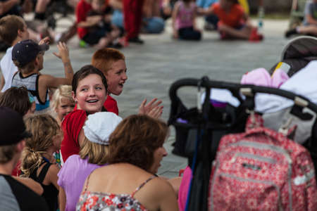DES MOINES, IA USA - AUGUST 10: Unidentified girl in audience at the Iowa State Fair on August 10, 2014 in Des Moines, Iowa, USA.
