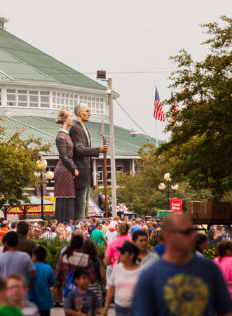 attendee: DES MOINES, IA USA - AUGUST 10: Attendees at the Iowa State Fair. Thousands of people filling the midway at the Iowa State Fair on August 10, 2014 in Des Moines, Iowa, USA.