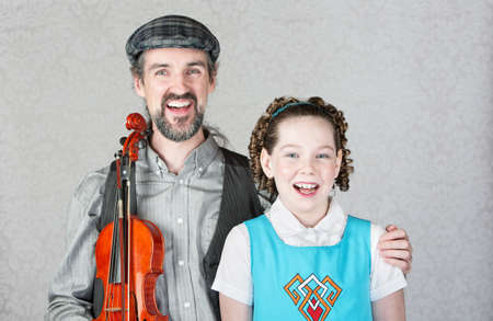 Happy irish folk musician and child laughing together Reklamní fotografie