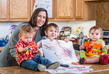 single parent: Mother poses with children in the kitchen