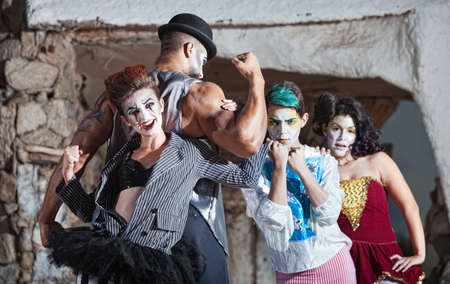 Bizarre comedia del arte performance ensemble outdoors