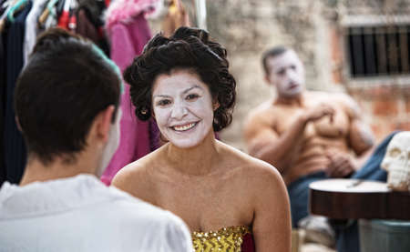 cirque: Female cirque clowns in make up sitting outdoors Stock Photo