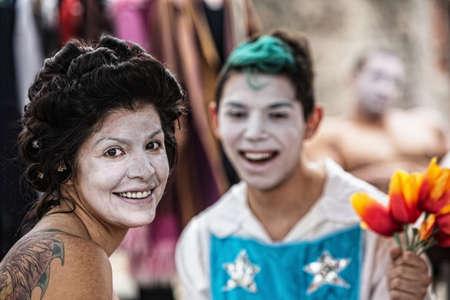 cirque: Cheerful Latino female cirque clown laughing with friend